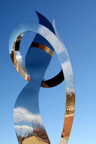A chrome statue on the OSU Tulsa Campus.