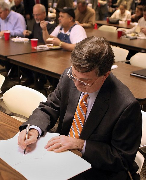 Chairman of the Port Authority Board Ed Fariss makes notes to his speech before presenting the Port of Catoosa's State of the Port Address Thursday.