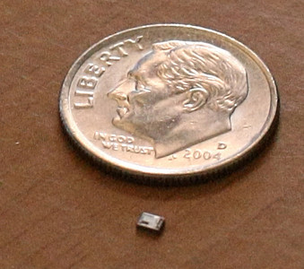 A nano chip about the size of a flake of pepper that was developed by Jim Callahan of Tulsa.