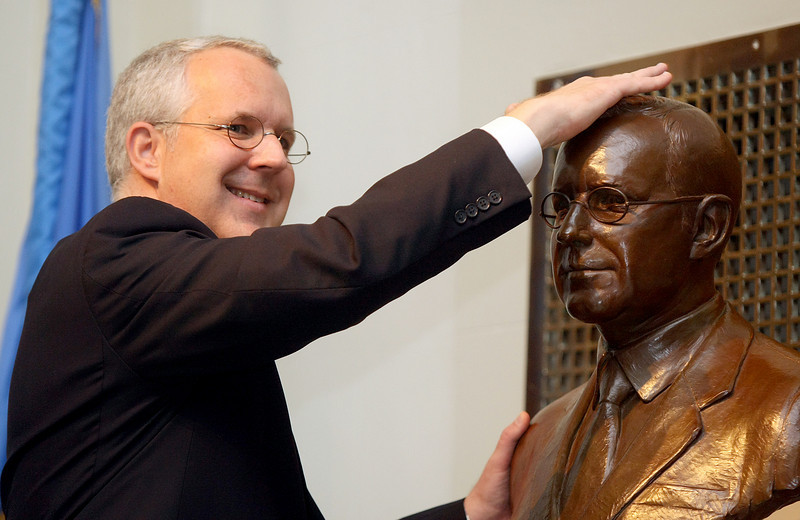 Gov. Brad Henry rubs his bronze bust for good luck Tuesday at the State Capitol during the unveiling ceremony. PHOTO BY MAIKE SABOLICH