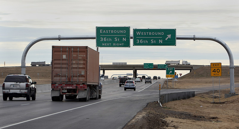 A monotube sign spans a recently widened stretch of Highway 169 between Tulsa and Owasso.