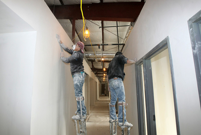 Ephrin Hernandez and Rigo Mora work on the construction sight of the Homeless Alliance's new<br /> resource center, the first major element of the West Town homeless services campus at 1729 NW Third Street, Monday. PHOTO BY MAIKE SABOLICH