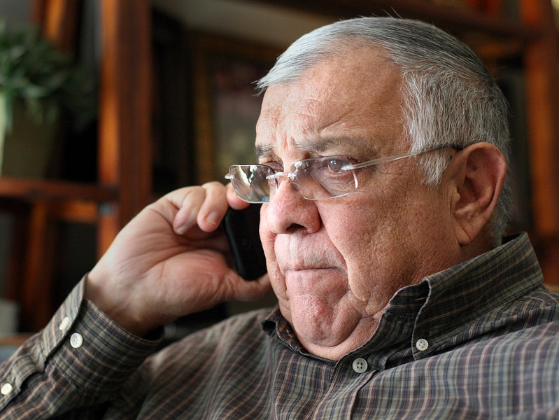 Jim Callahan chats on the phone at his Tulsa Office.