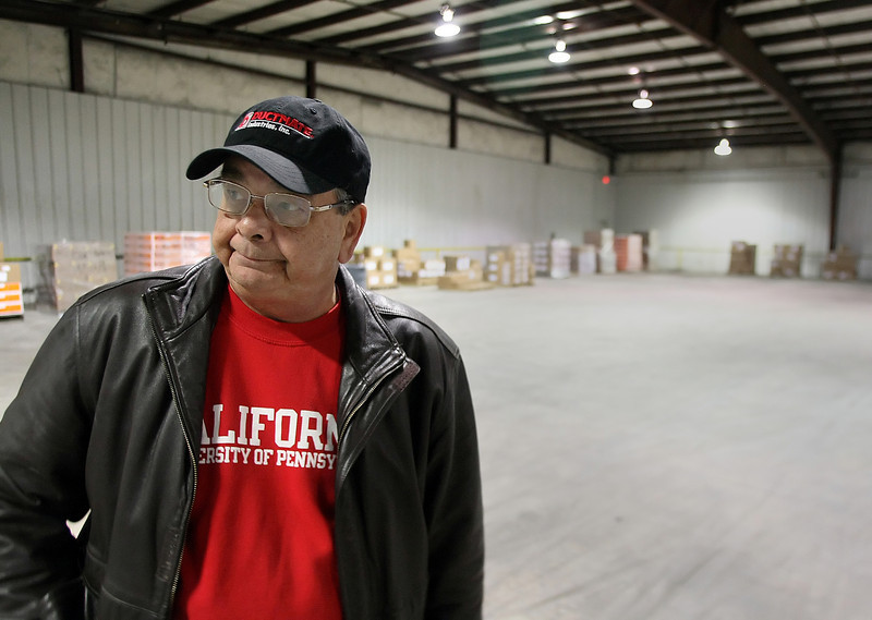 Tom Boyer, Corporate Project Manager for the DMI Companies, inspects part of a new 61,520 SF facility near the Tulsa International Airport the companies is renovating and expects to occupy soon.