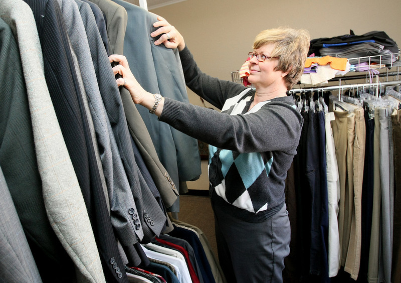 Valerie Robinson, human resources specialist at Oklahoma City University, sorts through jackets at Bluetique Monday. PHOTO BY MAIKE SABOLICH