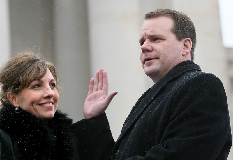 Lt. Gov. Todd Lamb is sworn into office with his wife, Monica, at his side Monday on the steps of the State Capitol. PHOTO BY MAIKE SABOLICH