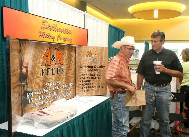 Bobby Jones and Brett Burk visit during the Oklahoma Cattlemen's Association Annual Convention and Trade Show at the Reed Center Thursday. PHOTO BY MAIKE SABOLICH