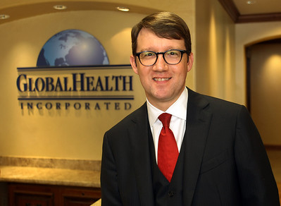 Scott Vaughn, Global Health Inc. President and CEO, pauses for a photo in the companies Tulsa office.
