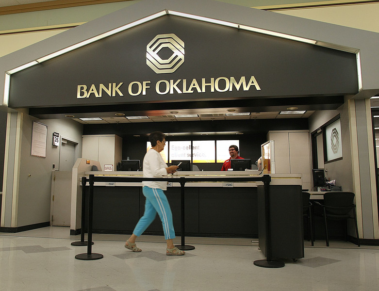 James McKenzie helps a Bank of Oklahoma customer at a bank branch located inside a grocery store in Tulsa.
