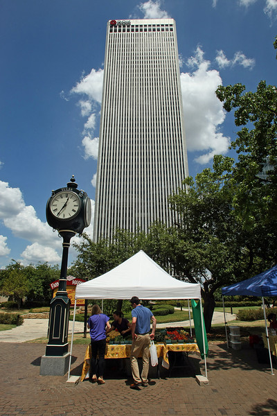 Emily Young and Tyler Strapington shop at downtown Tulsa farmers market during their lunch hour.