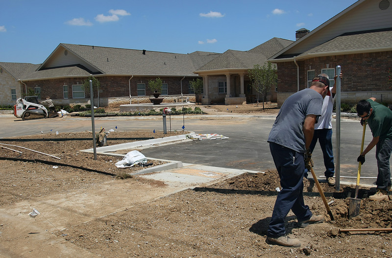 Bryan Deturk and Mike Mijs of Gilleys Electric  work to complete the $5 Million Autumn Leaves Alzheimer's care facility in South Tulsa.