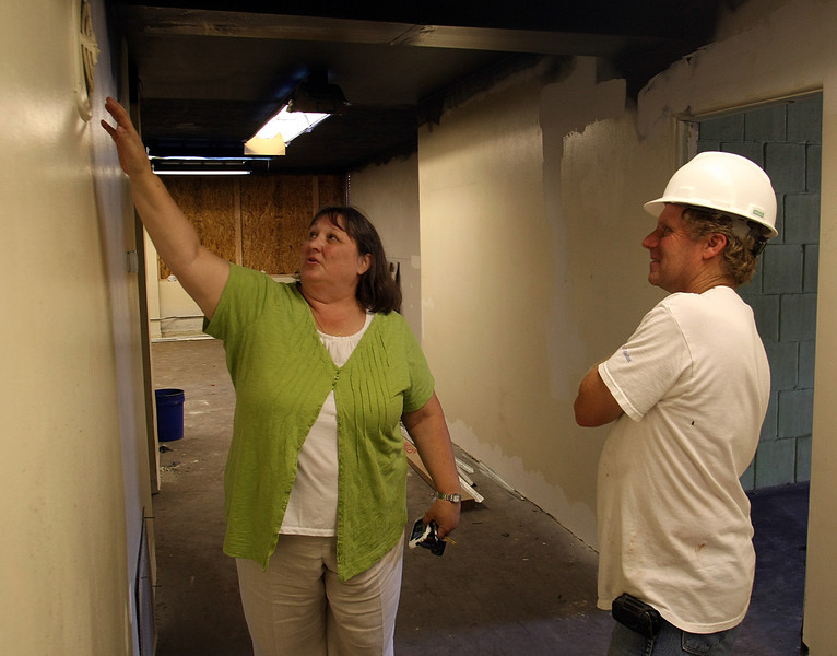 Julie Skrzypczak, Director of Operations for the Urban Tulsa Weekly,  checks on renovation progress at the papers new location.