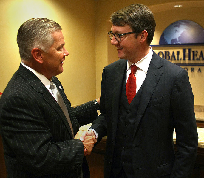 Oklahoma Insurance Commissioner John Doak greats Scott Vaughn , President of Global Health Inc., during a visit to the companies Tulsa offices.