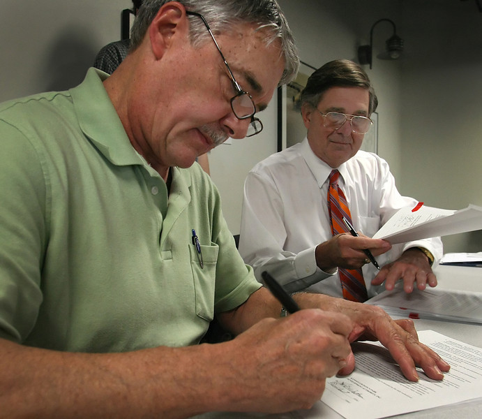 President, of the Kansas Logistic Park Development Authority John Waltner and Ed Fariss, Chairman of the City of Tulsa-Rogers County Port Authority sign a document agreeing to a working alliance for trade and transportation links between the Port of Catoosa and the Kansas Logistics Park in Newton Kansas.
