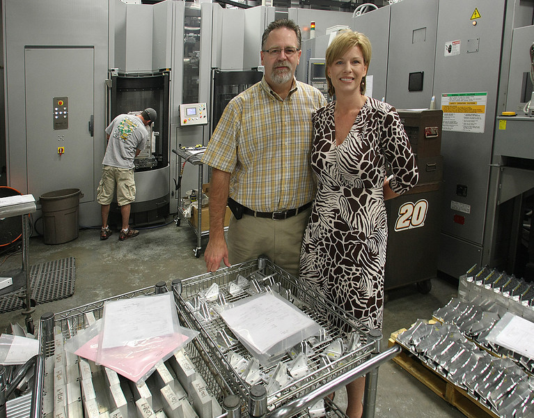 Kenny and Tonya Janeway, Chief Operating Officer and President of Janeway Machine, pause for a photo on their company's CNC production floor.