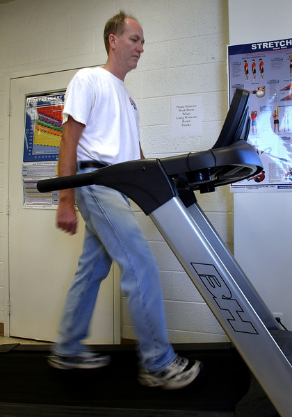 Vernon Copley uses the treadmill at the onsite gym at the Lafarge Cement complex in Tulsa.