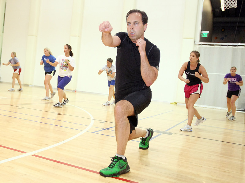 Bryan Ott, executive accountant at Chesapeake, takes a kickboxing class during lunch. PHOTO BY MAIKE SABOLICH