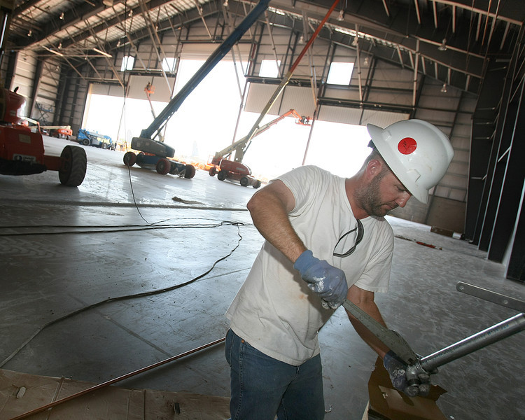 Robert Stidhan works on the new ARINC facility. PHOTO  BY MAIKE SABOLICH