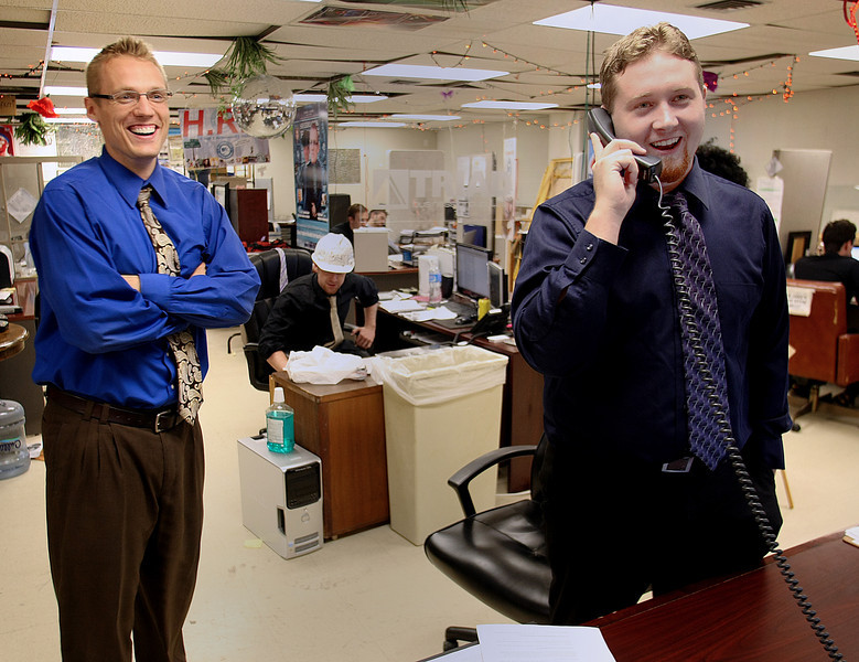 Clay Clark and Jason Bailey of Fears and Clark Realty Group and the DJ Connection share a laugh with a customer on the phone.