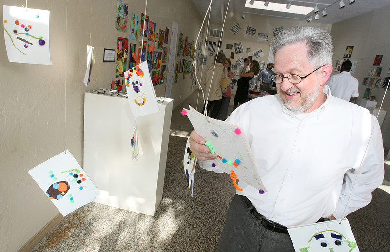 "Bruce Campbell looks at art exhibits at the Paseo ""First Friday"" art gallery walk Friday, May 6.  PHOTO BY MAIKE SABOLICH"