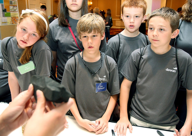 "Tori Wilpitz, Seth Arstingstall, Wiley Kerr, Caymen Robertson and other children study rocks during Devon Energy's ""Take Your Child to Work Day"" event at the Skirvin Thursday. PHOTO BY MAIKE SABOLICH"