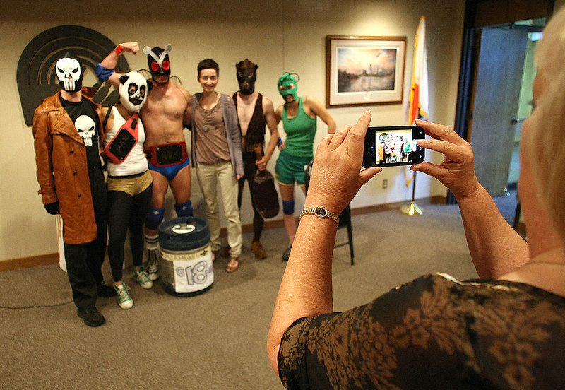 A group of luchadors pose for a photo after announcing the 2011 United Ways Fundraising goal of $24, 556,573.