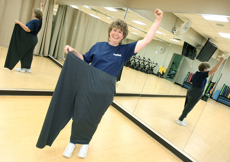Cheryl Lettenmaier, accountant in the financial management service department at American Fidelity Assurance Company, lost 109 punds. She can step into one pant leg of the pants that used to be tight. PHOTO BY MAIKE SABOLICH