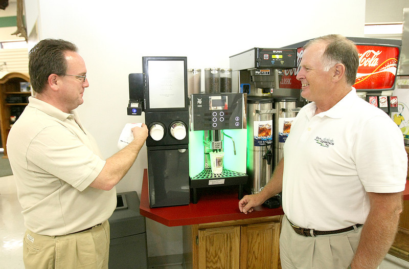 John Sharpley and Jerry Leeman with Perks Dynamics at the H&H Gun Range espresso kiosk.  PHOTO BY MAIKE SABOLICH