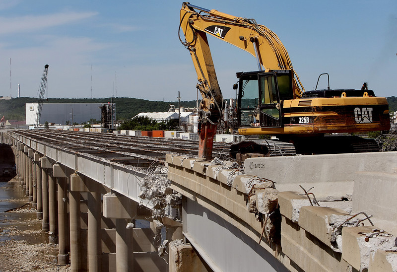 Crews continue demolition of the Westbound I-44 bridge in Tulsa.  A double-decked bridge allowing traffic above and Rain and pedestrian traffic below will replace the span.
