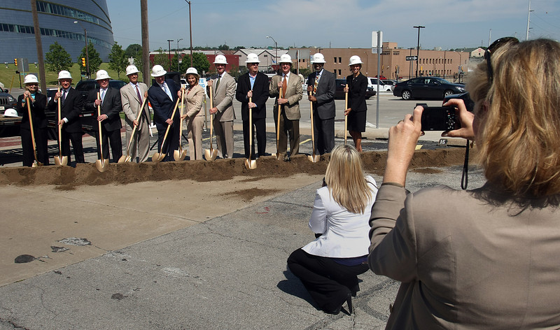 Past Mayor of Tulsa Kathy Taylor photographs dignitaries as they turn over a shovel of dirt in the parking lot that will soon become the One Place Tower.  The new 300,000 sq ft 18 story tower will become the Tulsa base for the Cimarex Energy Company.