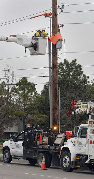 PSO linemen work to on overhead transmission lines.