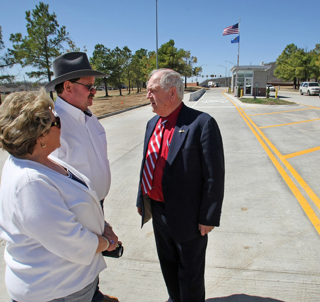 Port of Catoosa Director Bob Portiss, chats with attendees of Wednesday's dedication of the Port of Catoosa's new widened main entry point.