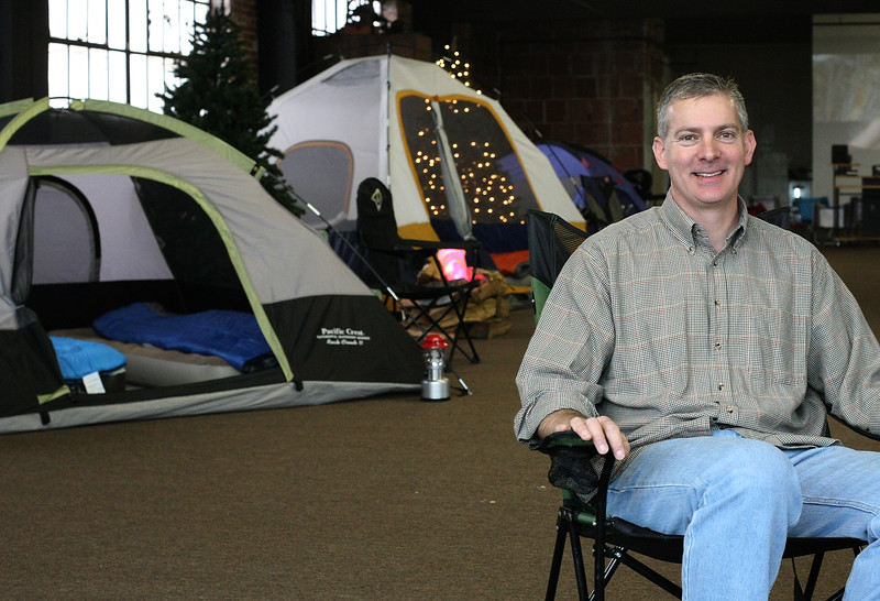 Mike Lassman sits among the many tents set up at the Urban Campout in Tulsa