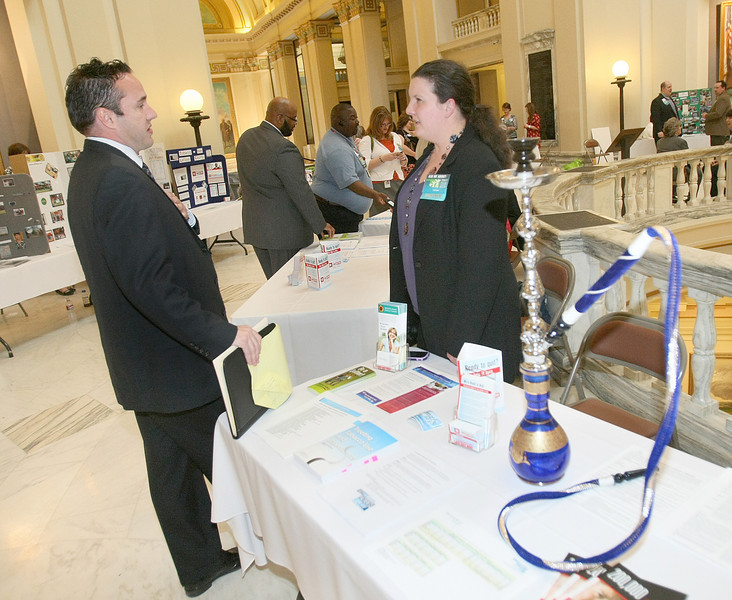 Brett Allred with Smoke Free Oklahoma Coalition and Tiffany Beasley with Tobacco Use prevention Service hang out visiting at the state Capitol Monday during an event of the Tobacco Settlement Endowment Trust.  PHOTO BY MAIKE SABOLICH