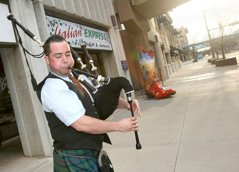 Jesse Bills plays the bagpipes in front of Main Street Parking Thursday in honor of St. Patrick's Day. PHOTO BY MAIKE SABOLICH
