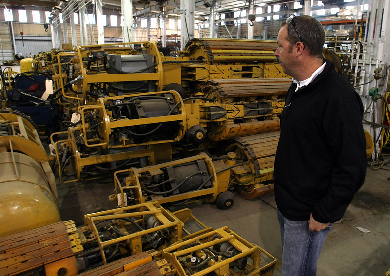 Bobby Darby, Vice President of Sales, inspects some of the tube bending equipment his company manufactures at their Tulsa facility.