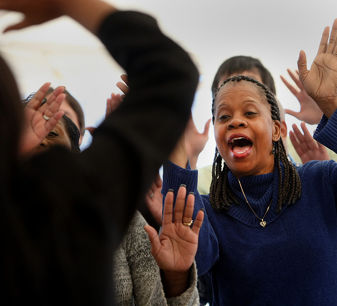 Choir singer Beverly Hughes sings during the Greater Cornerstone Community Development Project ground breaking on a 20,698 square-foot community center.