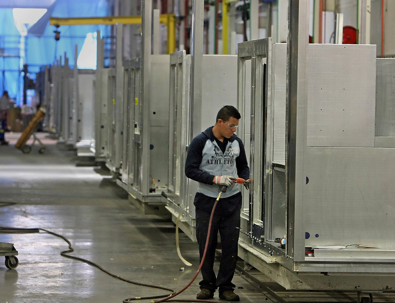 A workmen builds a large air conditioning unit at the AAON plant in Tulsa.
