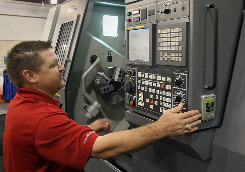 Troy Owen, Execujtive VP of Hillary Machinery, puts a CNC machine through it's paces.