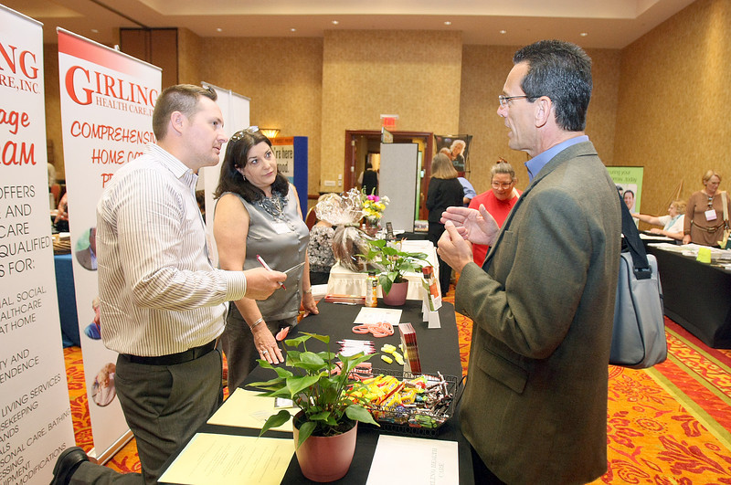 Tim Brittingham, Robin Breslin and Jeffrey Kidder visit during the 36th Annual Oklahoma Conference on Aging at the Embassy Suites in Norman Wednesday. PHOTO BY MAIKE SABOLICH