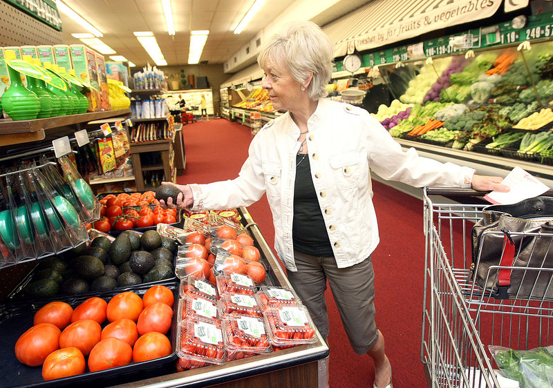 Suzanne Leggett shops at Crescent Market in Nichols Hills Wednesday. Downtown Oklahoma City residents still don't have a grocery store. PHOTO BY MAIKE SABOLICH
