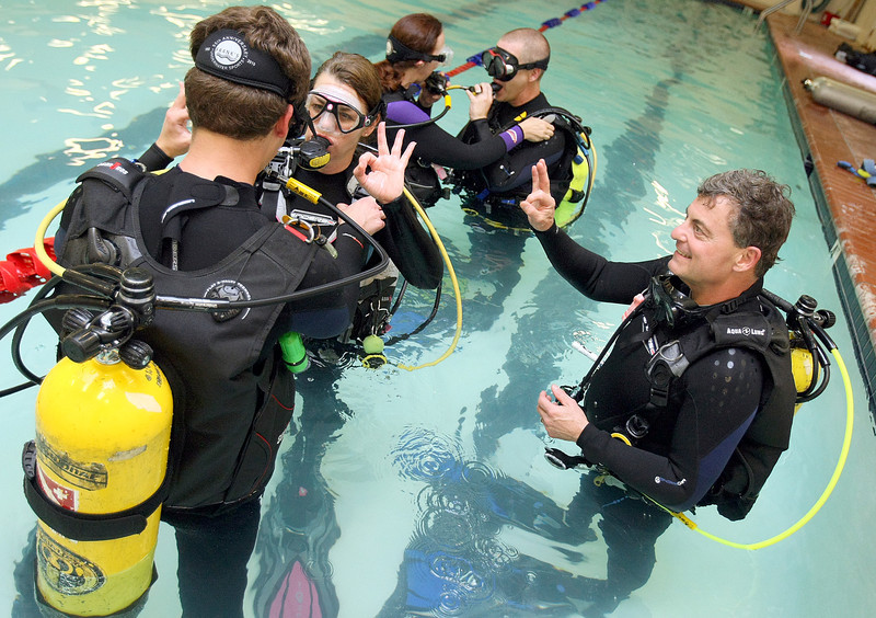 Frank Campbell, right, is a diving instructor.  He teaches diving classes at Transformation Fitness in Edmond. PHOTO BY MAIKE SABOLICH