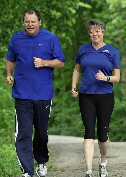 Lisa Wassom and Husband Lisa's her husband Robert jog along the Riverparks trail in Tulsa.