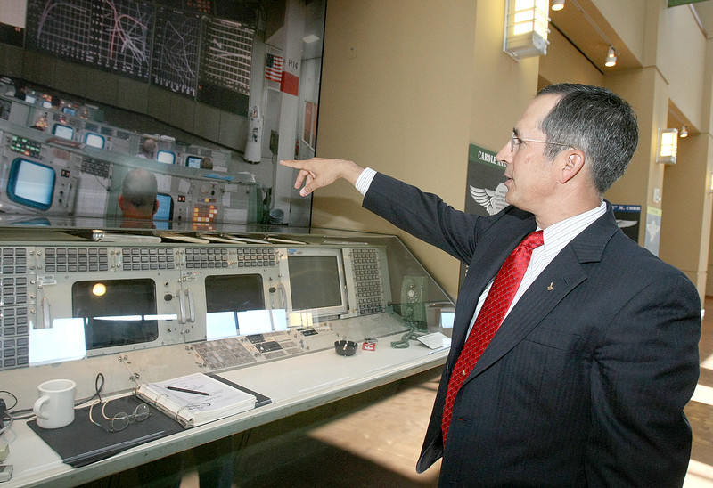 Former astronaut John Herrington, a native of Wetumka, points to a new exhbit dovoted to Oklahomans in space at the Oklahom History Center. PHOTO BY MAIKE SABOLICH