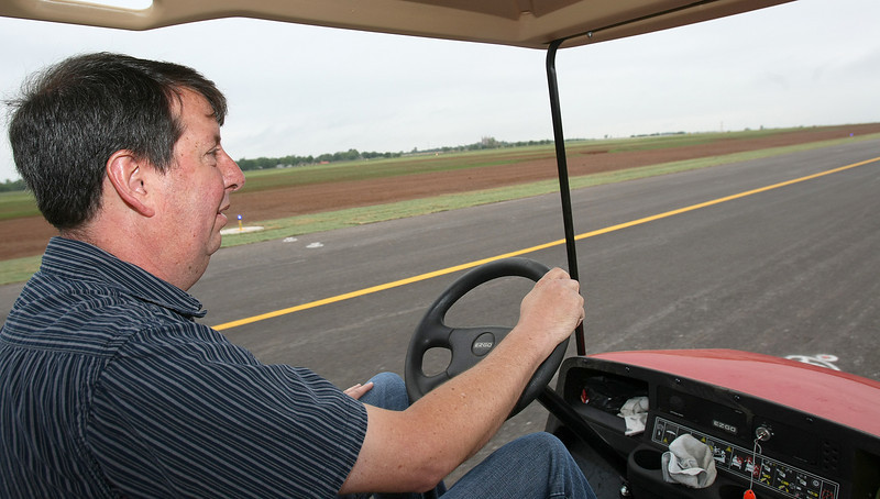 Rex Hennen, Shawnee Assistant Airport Manager, gives a tour of the newly paved taxiways. PHOTO BY MAIKE SABOLICH