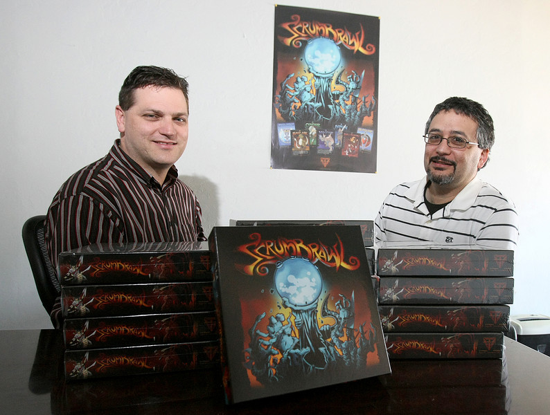 Vic Moyer and Tarek Dina with their new game ScrumBrawl.  PHOTO BY MAIKE SABOLICH