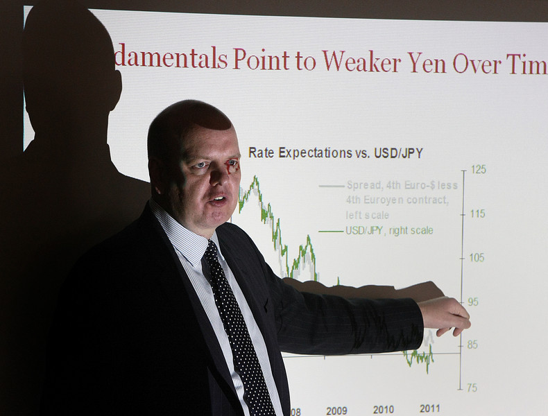 Nick Bennenbroek, Head of Currency Stategy for Wells Fargo Bank, gives his Foreigh Exhange in 2011 presentation at a luncheon in Tulsa.
