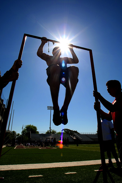 A Jenks High School student does chin-ups as part of a physical fitness routine put on by the U.S. marine Corps.
