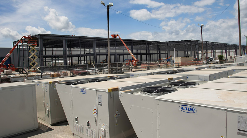 Large air conditioning units sit outside the expansion project currently underway at Tulsa based AAON.