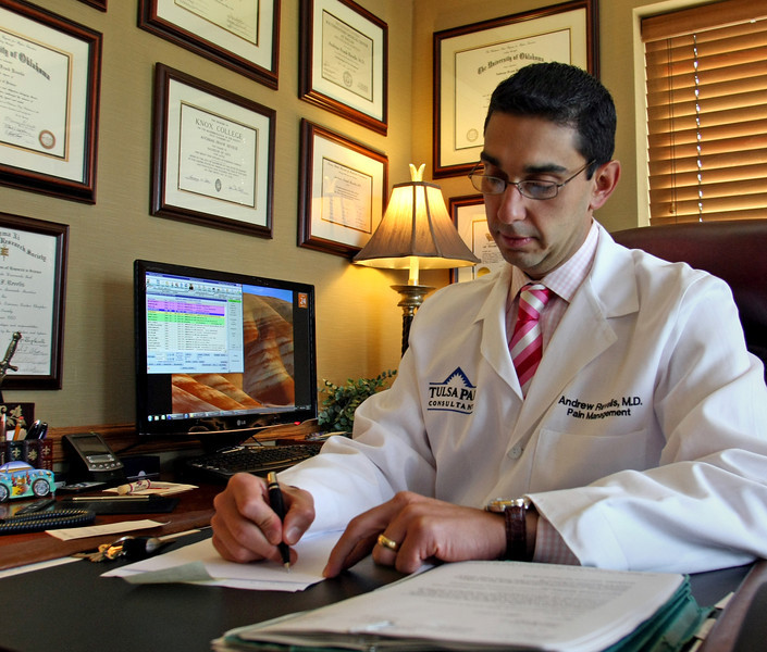 Dr. Andrew Revelis in his office at the Tulsa Pain Consultants Clinic.